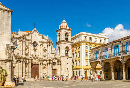 Cathedral Square with catholic church, bell tower and old buildings, historical center of Old Havana, Cuba Editorial