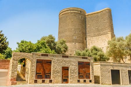 Azerbaijani stone buildings with  Gız Galası medieval Maiden tower, old town, Baku, Azerbaijan Banco de Imagens