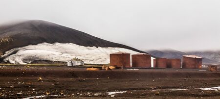 Abandoned norwegian whale hunter station rusty blubber tanks panorama at Deception island, Antarctic 写真素材