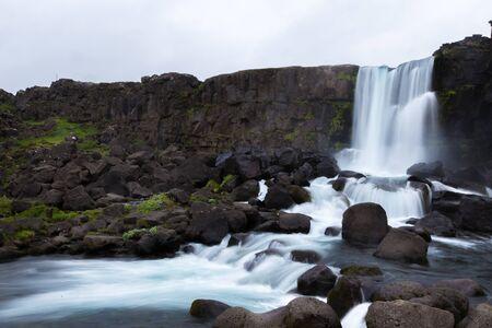 Oxararfoss waterfall streams falling from the mountain, Tingvellir National Park, Iceland