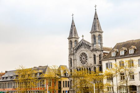 Street with church of the Redemptorists of Tournai, Walloon municipality, Belgium Banco de Imagens