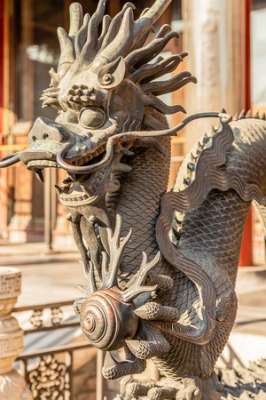 Chinese Dragon statue from Ming dynasty era, at the entrance to the palace in the Forbidden City, Beijing, China Editorial
