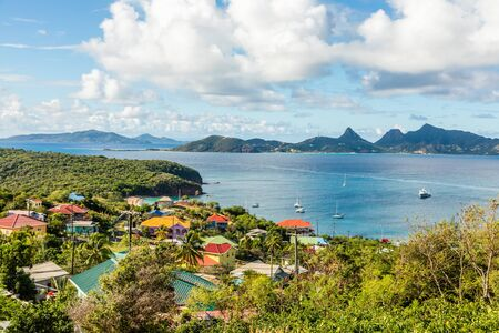 Residential houses at the bay, Mayreau island panorama with Union island in the background, Saint Vincent and the Grenadines
