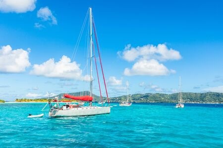 Turquoise sea and anchored yachts near Carriacou island, Grenada, Caribbean sea