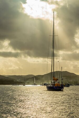 Sunset view of Rodney bay with yachts anchored in the lagoon, Saint Lucia, Caribbean sea Banco de Imagens