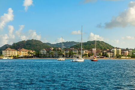 Offshore view of Rodney bay with yachts anchored in the lagoon and rich resorts Stock Photo