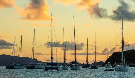Sunset panorama with lots of parked yachts and catamarans, Tobago Cays, Saint Vincent and the Grenadines, Caribbean sea