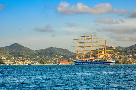 big naval clipper anchored at the Rodney bay with town in the background, Saint Lucia, Caribbean sea Banco de Imagens - 140005878