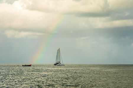 Catamaran at Rodney bay with rainbow in the backround, Saint Lucia, Caribbean sea Banco de Imagens