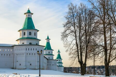 Snow and white towers with green roof of New Jerusalem Monastery fortified walls, Istra, Moscow region, Russia Stock Photo