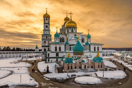 Voskresensky cathedral golden domes in a sunset light, covered in snow, Resurrection or New Jerusalem Monastery, Istra, Moscow region, Russia Stock Photo