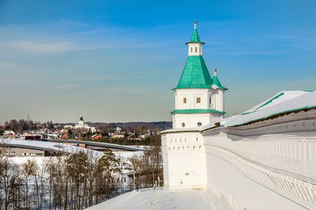 Fortified walls and white towers with green roof, winter landscape, New Jerusalem Monastery , Istra, Moscow region, Russia