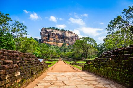 Sigiriya or Lion rock - ancient rock fortress with brick wall in the foreground, Dambulla, Central Province ,Sri Lanka