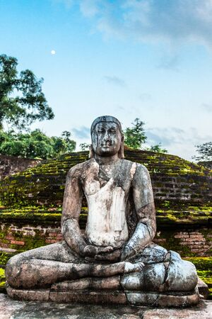Meditating buddha statue in ancient city of Polonnaruwa, North Central Province, Sri Lanka
