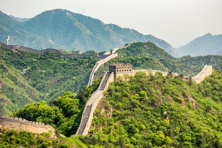 Panorama of Great Wall of China among the green hills and mountains near Beijing, China