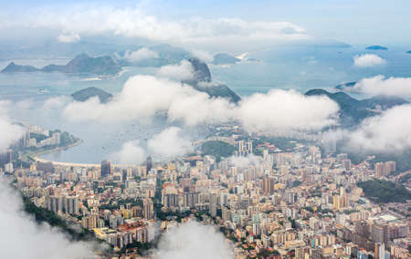 Rio city center downtown panorama with coastline and Sugar Loaf mountain covered in clouds, Rio de Janeiro, Brazil