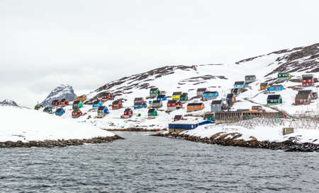 Colorful arctic fishing village houses at the rocky fjord  in the middle of nowhere, Kangamiut, Greenland