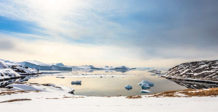 Ice fields and drifting Icebergs at the Ilulissat fjord, North Greenland