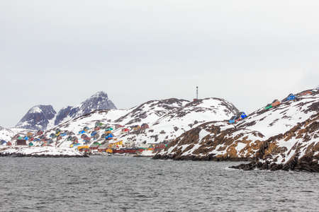 Colorful arctic village houses at the rocky fjord  in the middle of nowhere, Kangamiut, Greenland