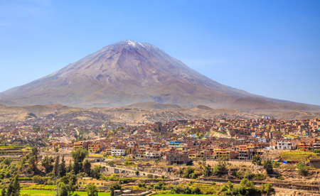 Dormant Misti Volcano over the streets and houses of peruvian city of Arequipa, Peru Stock Photo
