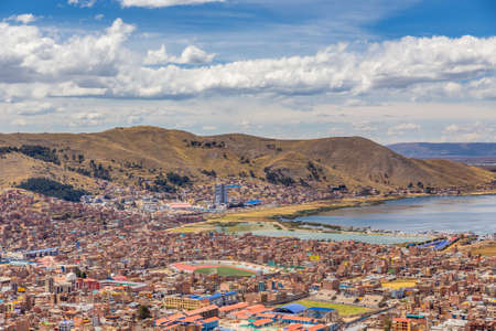 Panorama of peruvian city Puno and lake Titicaca, Peru Stock Photo