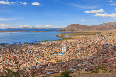 Panorama of peruvian city Puno and lake Titicaca, Peru Editorial