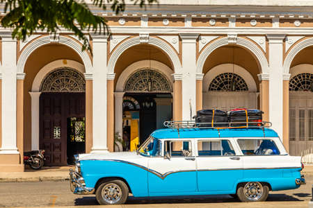 Old red and white cabriolet retro car in the center of Havana, Cuba Stock Photo
