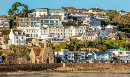 Saint Aubin town seashore view with Sacred heart of Jesus church,, bailiwick of Jersey, Channel Islands Banco de Imagens