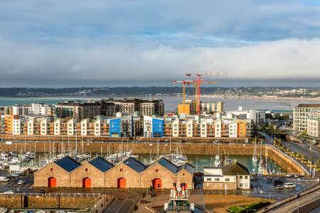 Saint Helier capital city panorama with port and marina in the foreground, bailiwick of Jersey, Channel Islands