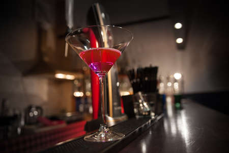 a glass of cocktail on the bar