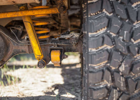 Studded SUV car tires with reinforced suspension on the sand