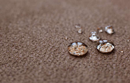 Drops of water on a water resistant fabric of brown color Imagens