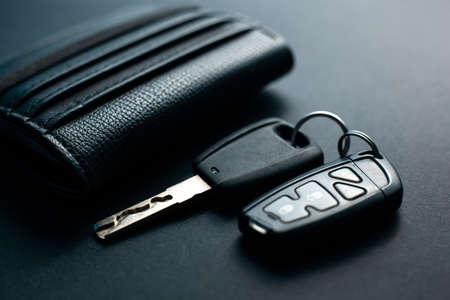 Black leather wallet with car key on a black background 版權商用圖片 - 130135670