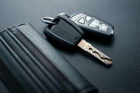 Black leather wallet with car key on a black background 版權商用圖片 - 130135673
