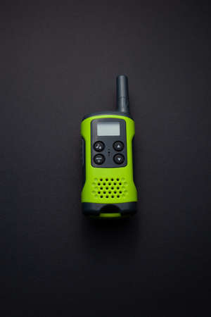 Light green walkie talkie on isolated on black background