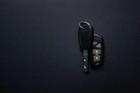 Car keys with remote from car alarm on isolated black background 版權商用圖片 - 130135684