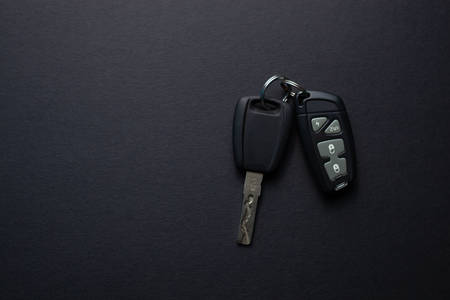 Car keys with remote from car alarm on isolated black background Фото со стока - 130135686