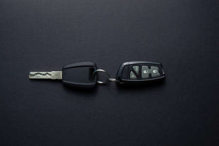 Car keys with remote from car alarm on isolated black background
