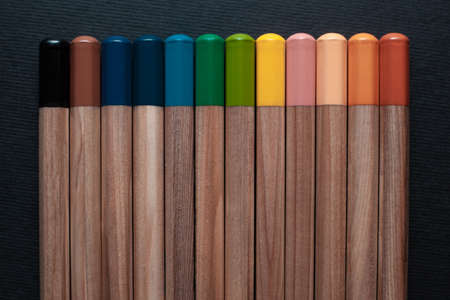 Not sharpened pencils of different colors isolated on a black background Archivio Fotografico - 130135752