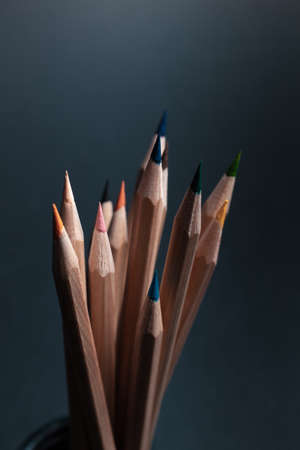 Sharpened pencils of different colors made of light wood isolated on black background. Archivio Fotografico - 130135761
