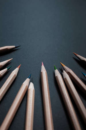 Sharpened pencils of different colors made of light wood isolated on black background. Archivio Fotografico - 130135770