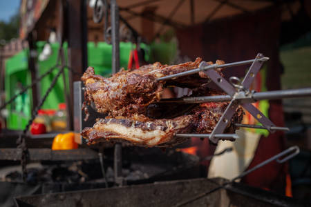 Marinated fried pork ribs cooked on a skewer over charcoal