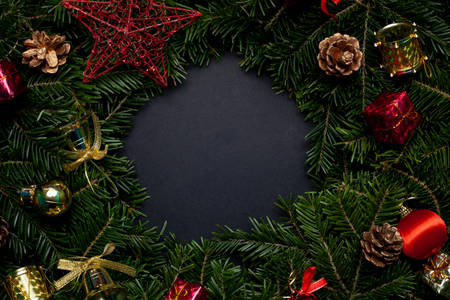 Christmas wreath decorated with toys and a red star with a black background in the center