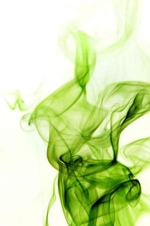 vertically: Green smoke rising vertically on white background.
