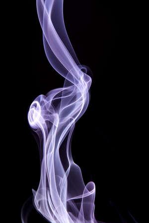 wisp: Purple smoke wisp rising against black background