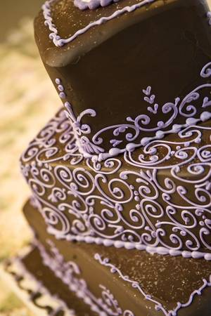 square: Chocolate wedding cake close up with details in purple.