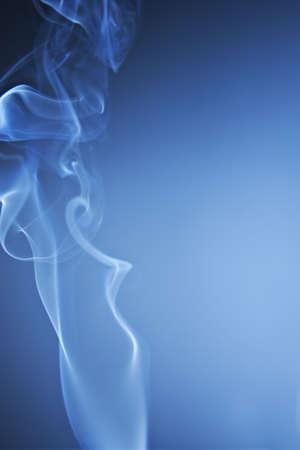 White Smoke Rising on Spot Lit Blue Background