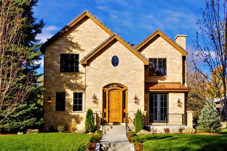 All stone facade two story luxury home in Denver, Colorado, United States.