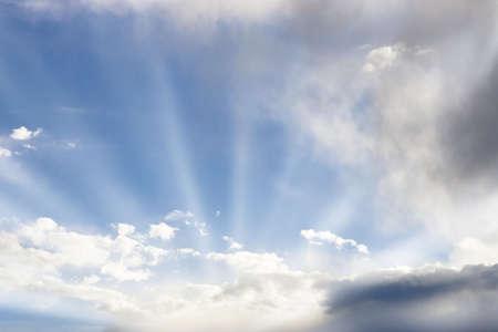 Sun beams through bright lit clouds.