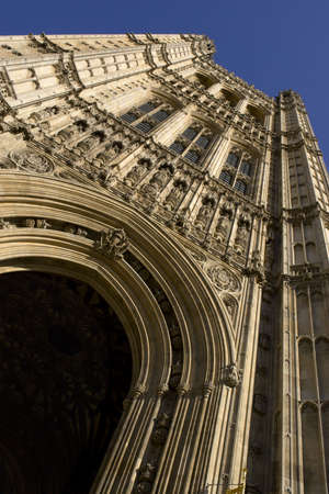 english famous: Extreme view of entrance tower at the Houses of Parliament in London, England.